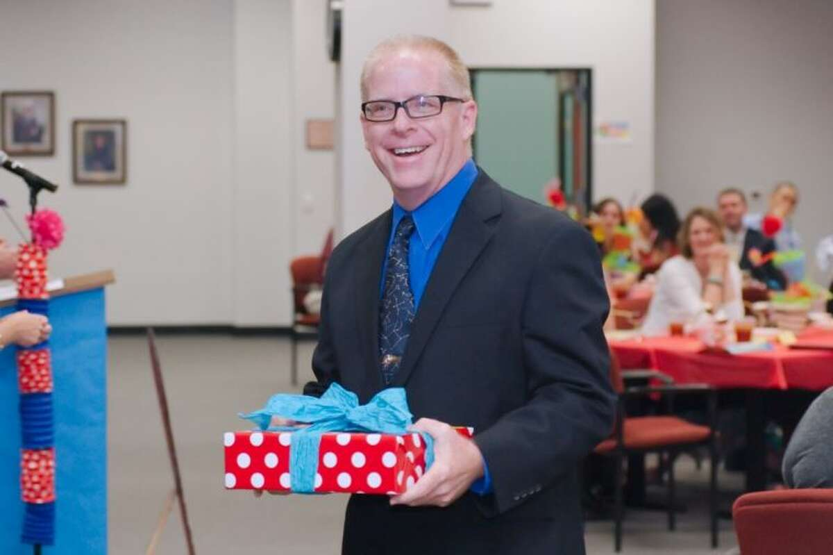 Dawson High School Teacher Mark Lesmeister is selected as the Secondary School Teacher of the Year during the 2014 Pearland Independent School District Employee Awards Celebration Friday, May 3.