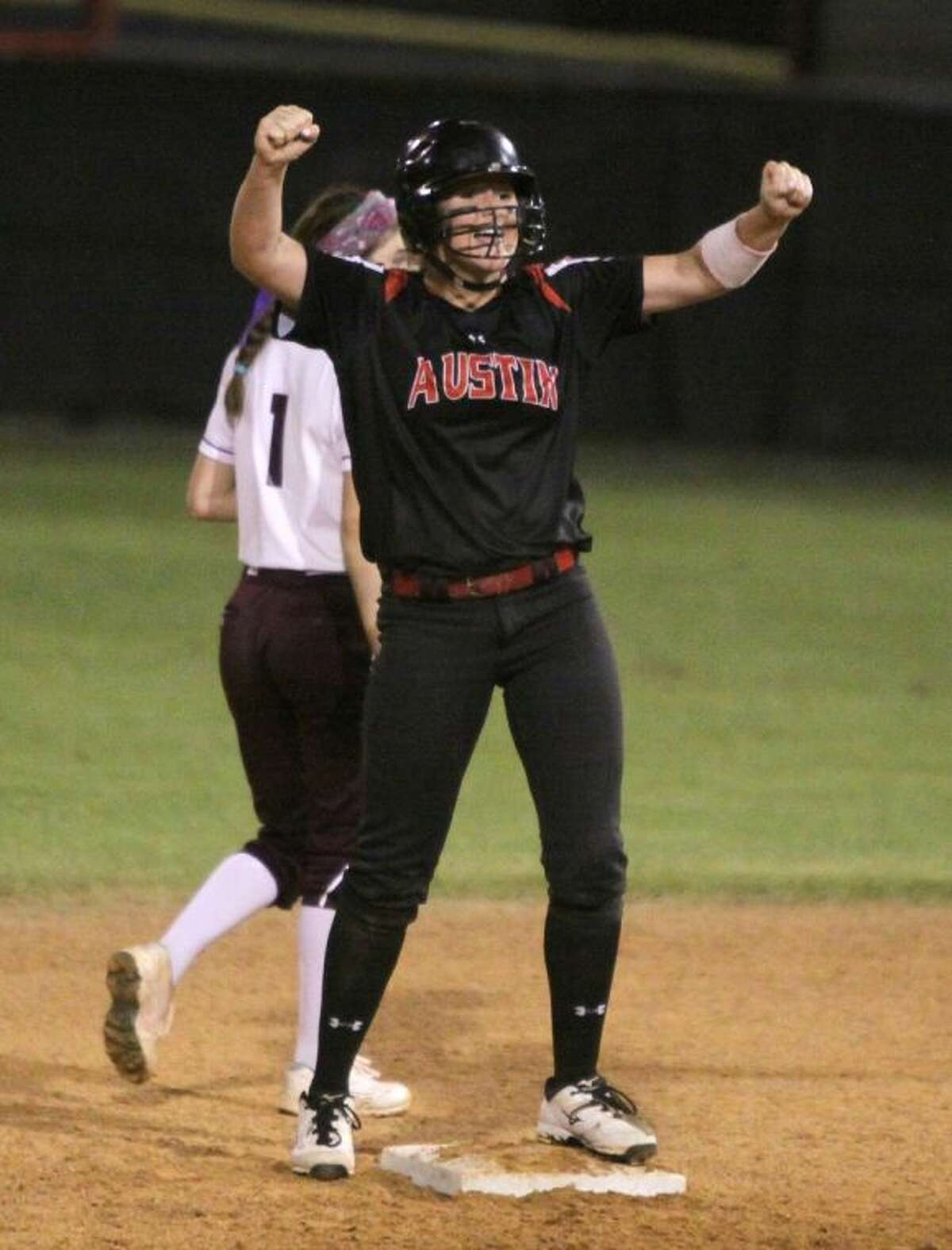 Fort Bend Austin's Brooke Vannoy celebrates on second base after hitting a double to push in the winning run in the 6th inning against Clear Creek Aug. 25 at Austin High School.
