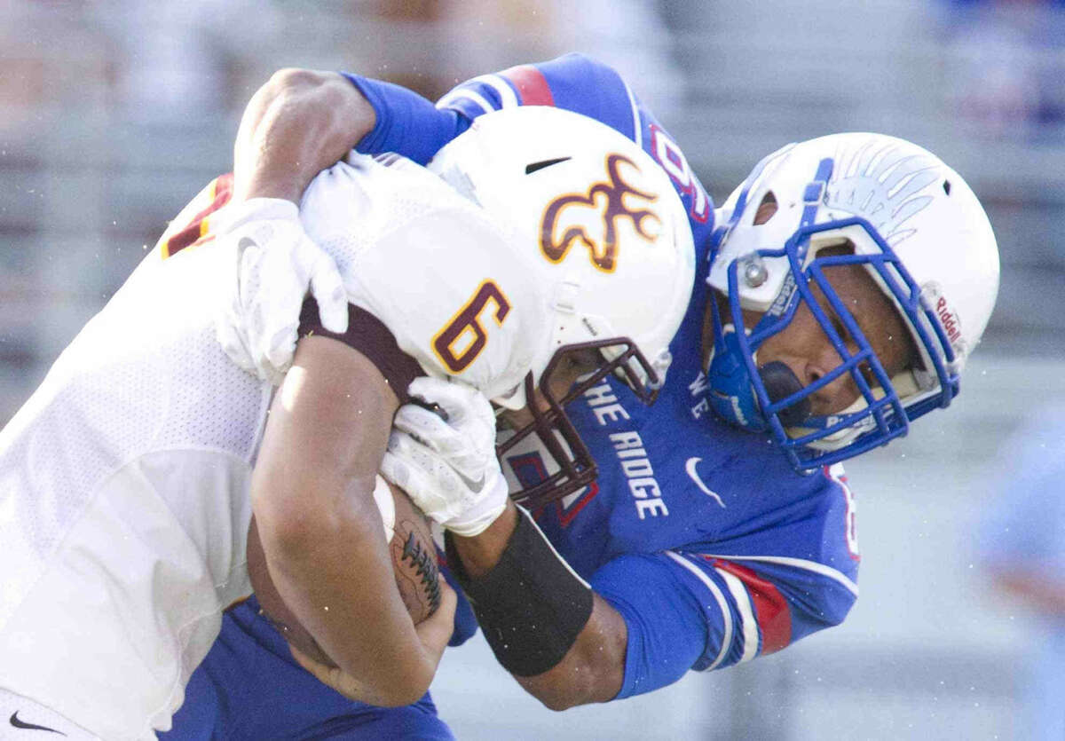 Oak Ridge linebacker Nick Durst tackles Deer Park running back Sammy Linton during a high school football game at Woodforest Bank Stadium Saturday. Deer Park defeated Oak Ridge 45-38. To view or purchase this photo and others like it, visit HCNpics.com.