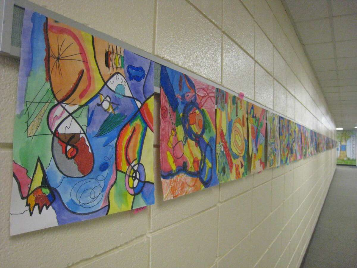 Current Foster Elementary students created artwork and poems celebrating the school's 45th anniversary which were displayed in the hallways for guests to enjoy.