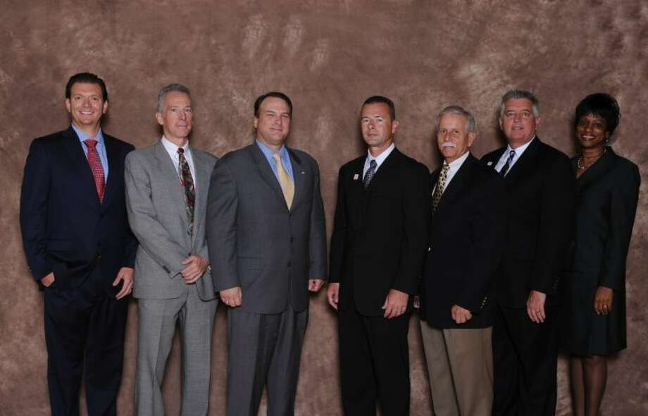 The Katy Family YMCA has inducted new board members. Along with Katy Family YMCA Board Chairperson, Matt Schomburg, left and Renita King, Chairperson of the Board Development Committee, pictured are new board members, Kevin Campbell, Robert Burns, Steve Reichardt, Ralph Fluker and George Adkins. Photo: Submitted