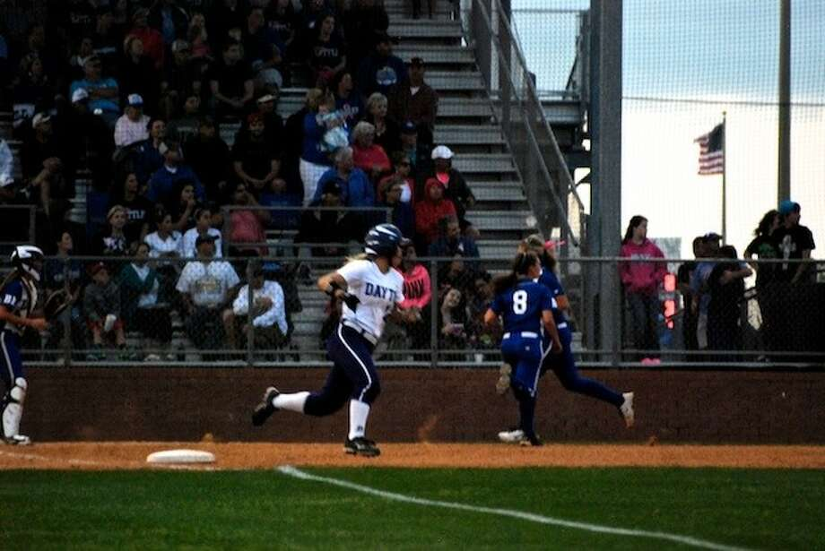 Alexis Kimball rounds first and heads for second on a double in the fifth inning at Barbers Hill Friday, April 11. Photo: CASEY STINNETT / Houston Community Newspapers, 2014