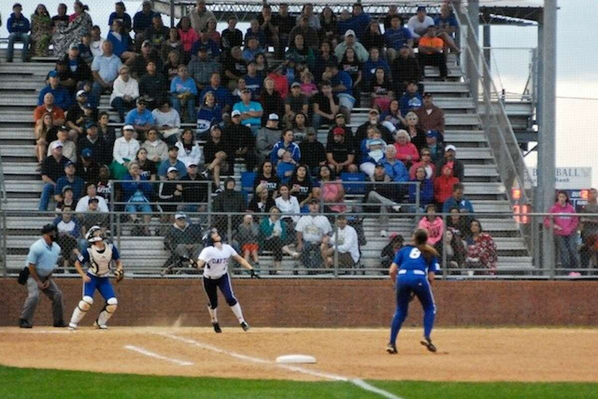 Ravin Wilson follows the high fly ball she hit in the fifth inning that nearly brought in a run for Dayton, but the Lady Eagles were quick and Alexis Kimball was out at home.