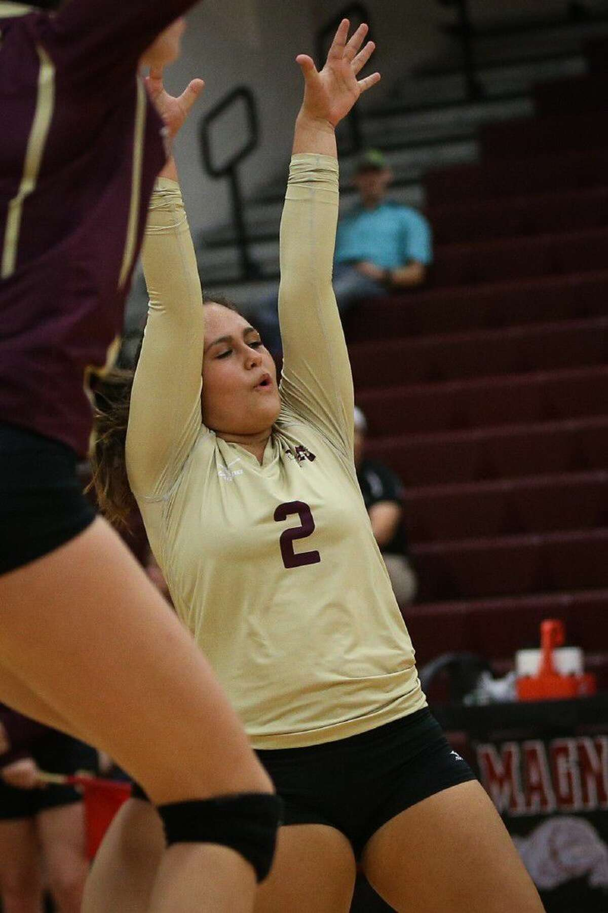 Magnolia West's Nicole Grant (2) celebrates during the varsity volleyball game against Magnolia on Tuesday at Magnolia High School.