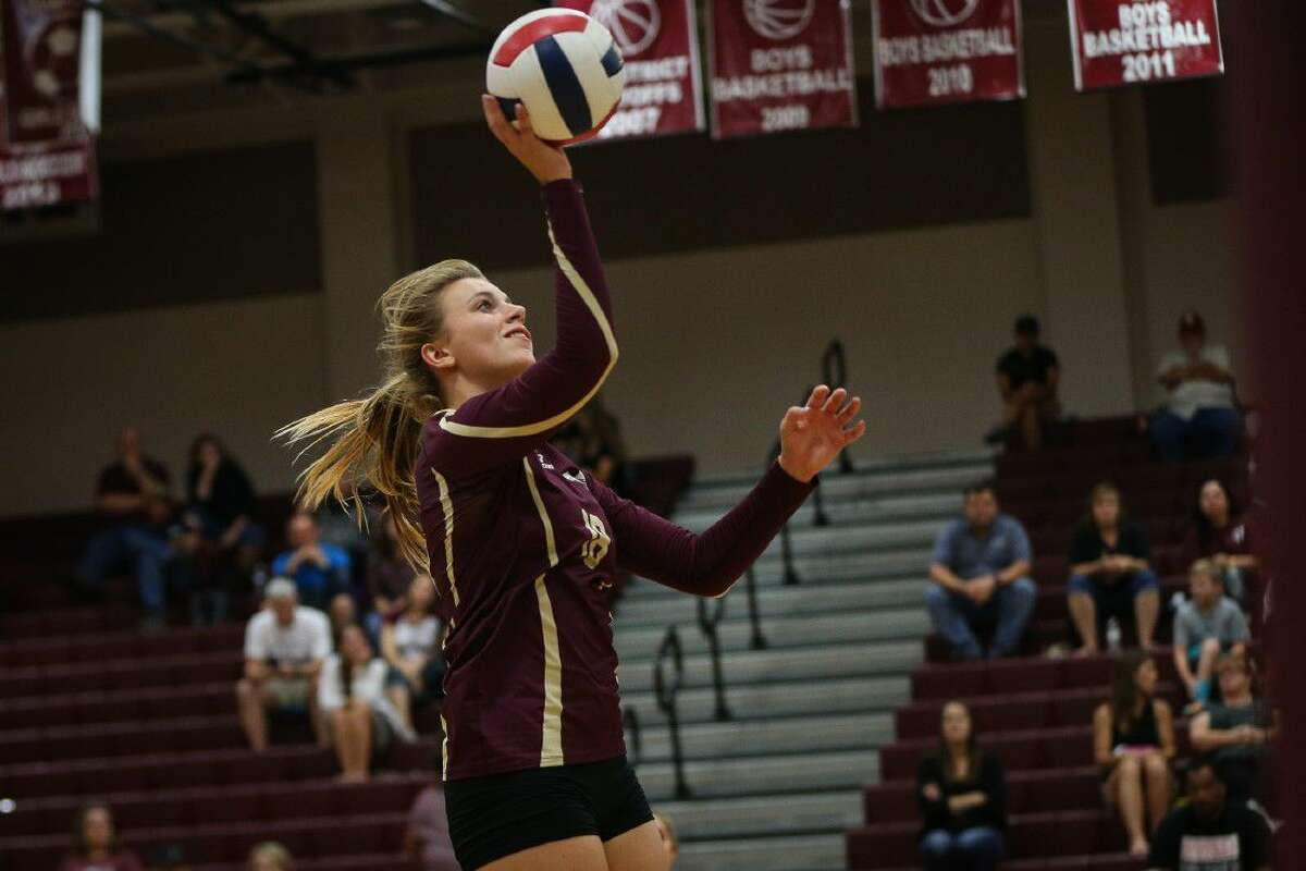 Magnolia West's Hannah Eggleston (18) hits the ball during the varsity volleyball game against Magnolia on Tuesday at Magnolia High School.