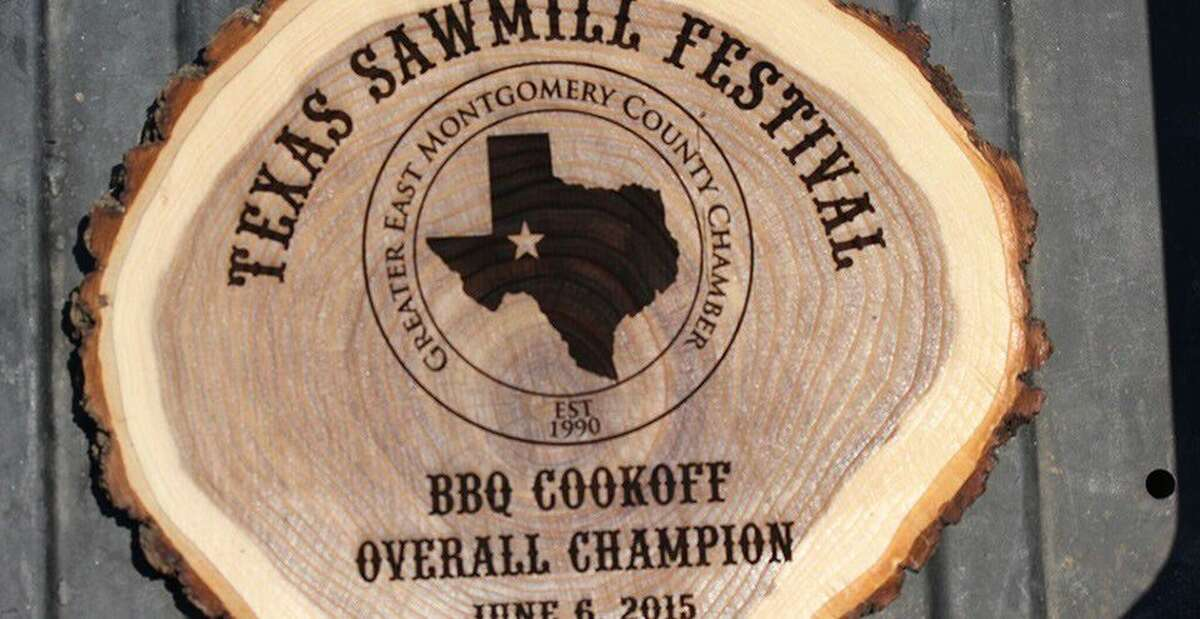 The Greater East Montgomery County Chamber's Texas Sawmill Festival's logo is emblazoned on a log in preparation for the Oct. 1 event in New Caney.