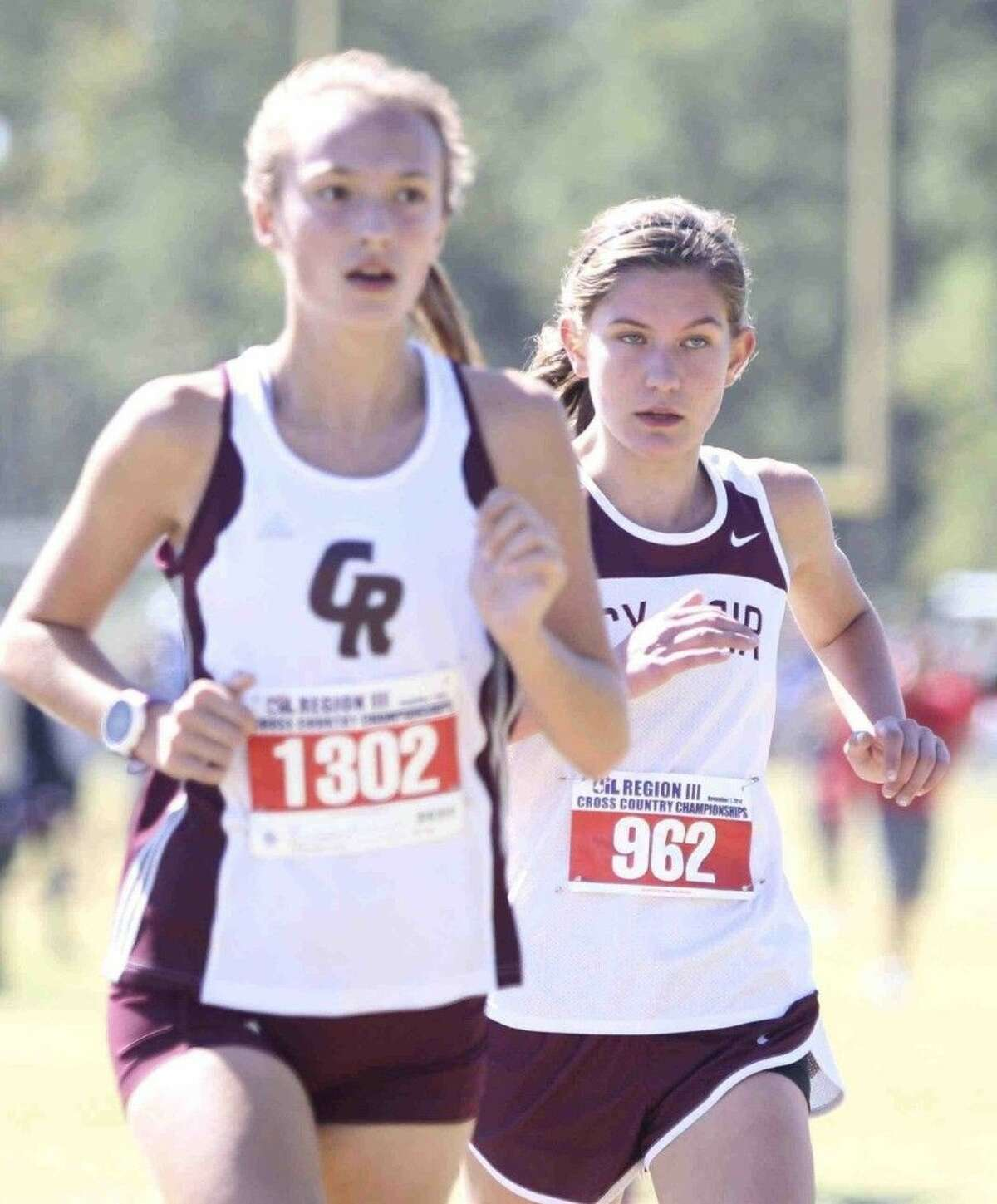 Isabelle Nielson (left) and Cinco Ranch won the Spring Branch ISD Invitational, Sept. 17 at Nottingham Park.