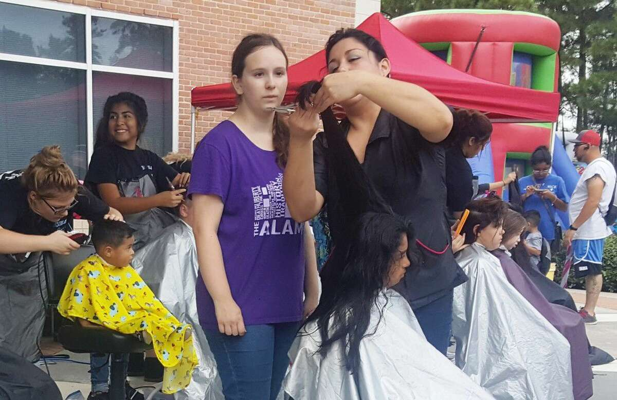 New Caney High School Cosmetology provides children with free haircuts during the annual Back to School Bash hosted by the East Montgomery County Improvement District at the EMCID Complex Sept. 13.