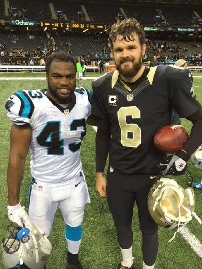 Former Pearland Oiler football players Fozzy Whittaker (left) of the Carolina Panthers and Thomas Morstead of the New Orleans Saints met Sunday in New Orleans. The Panthers won the game, 41-10. Photo: Photo Courtesy Isobel Morstead