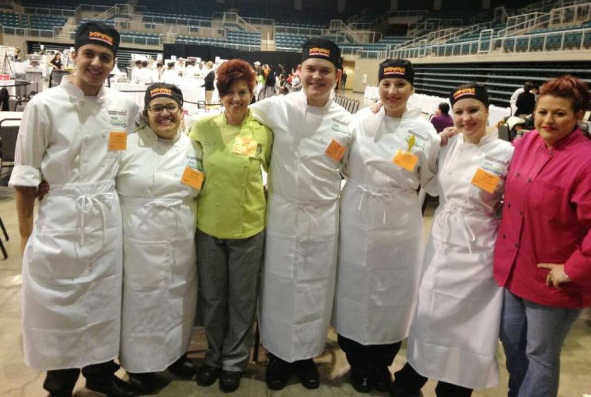 Six students from the CFISD Culinary Academy placed ninth out of 29 teams at the prestigious Texas ProStart Invitational Feb. 7-8 in Katy. Pictured, from left, are Joshua Rai, Cypress Woods senior; Yesenia Ramirez, Langham Creek senior; Kara Palermo, Cy-Fair Culinary Academy instructor; Kyle Wagner, Cypress Woods senior; Shelby Richey, Cypress Woods junior; Amber Dilling, Langham Creek senior; and Brenda Richey, mentor/coach.