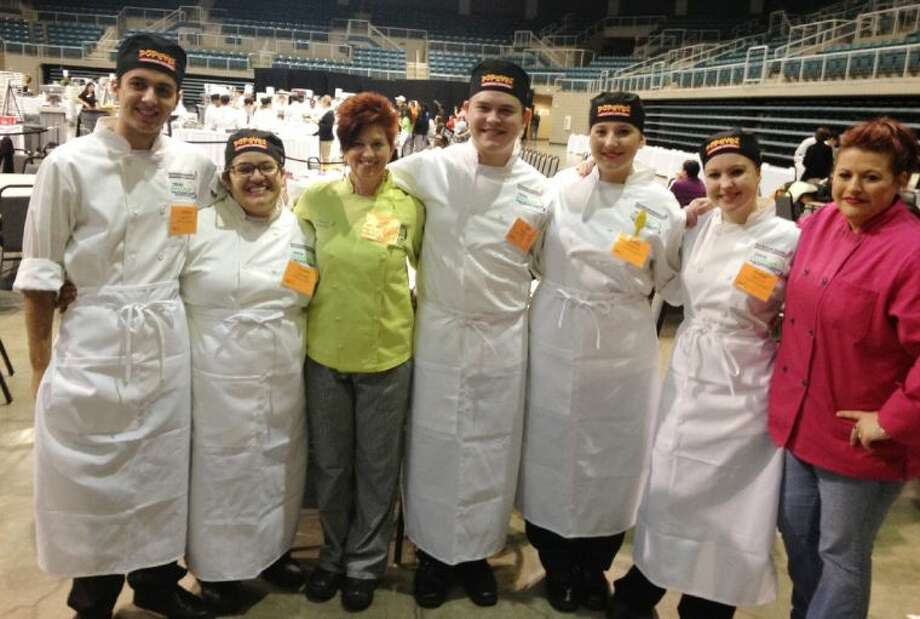 Six students from the CFISD Culinary Academy placed ninth out of 29 teams at the prestigious Texas ProStart Invitational Feb. 7-8 in Katy. Pictured, from left, are Joshua Rai, Cypress Woods senior; Yesenia Ramirez, Langham Creek senior; Kara Palermo, Cy-Fair Culinary Academy instructor; Kyle Wagner, Cypress Woods senior; Shelby Richey, Cypress Woods junior; Amber Dilling, Langham Creek senior; and Brenda Richey, mentor/coach. Photo: Submitted Photo