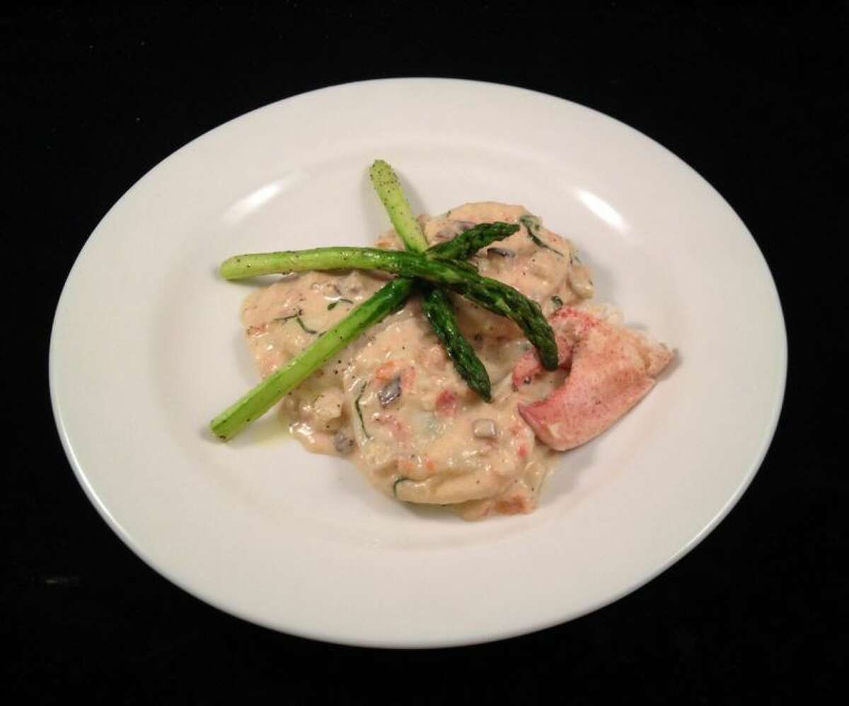 CFISD Culinary Academy students prepared the entrée Ravioli Di Aragosta, a butter-poached lobster and ricotta-stuffed ravioli in a mushroom, tomato and sherry cream sauce topped with sautéed asparagus and lobster claw.