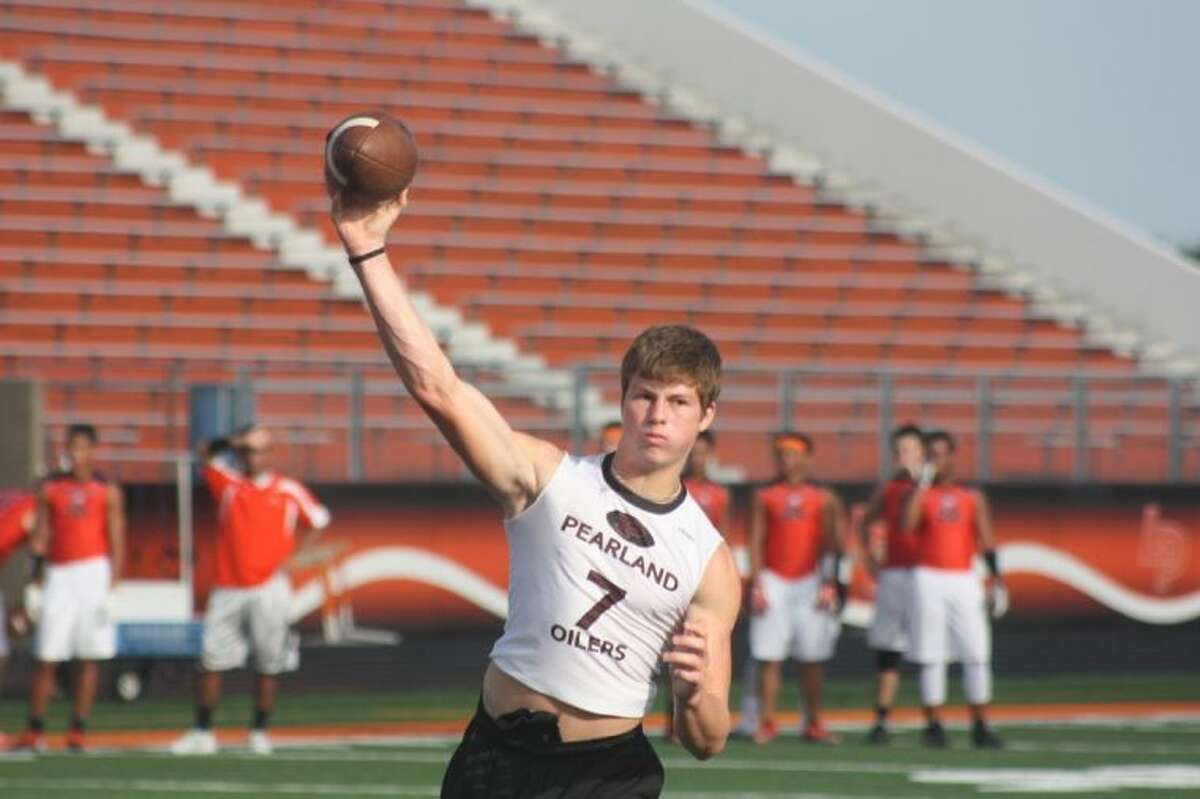 Pearland quarterback Jake Blumrick zeroes in on receiver Daniel Petty for a short touchdown pass during the Oilers' 7-on-7 contest with La Porte at Bulldog Stadium Monday night. Blumrick and Petty tied the game in the early minutes, but La Porte would go on to capture a 27-14 victory. After the Bulldogs snapped a 14-14 tie, a La Porte interception prevented Pearland from tying the game a third time. Jacob Whitehead accounted for Pearland's other touchdown pass, a second scoring strike to Petty.