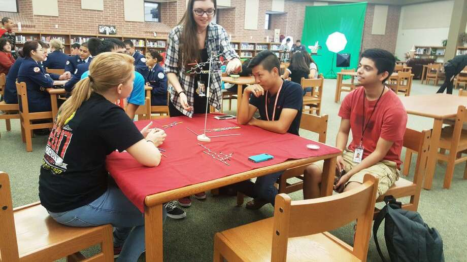 Students play a strategy game in the new makerspace at Porter High School's media center during the ribbon cutting ceremony hosted by the New Caney ISD Education Foundation Thursday, Sept. 15.