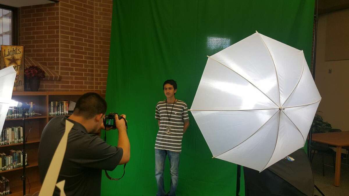 Two students use the green screen area in the new makerspace at Porter High School's media center during the ribbon cutting ceremony hosted by the New Caney ISD Education Foundation Thursday, Sept. 15.