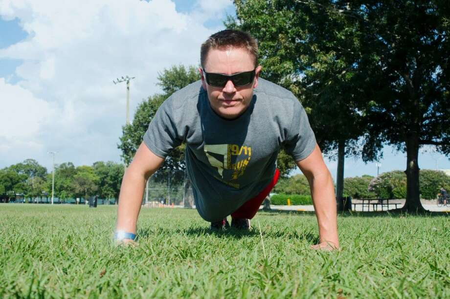 Pushups are part of Pasadena police Lt. Thomas Warnke's regimin after he went through treatment and rehabilitation for paralysis caused by a rare autoimmune neurological disorder called transverse myelitis that left him unable to walk. His doctor says Warnke's progress has been extraordinary. Photo: Kirk Sides