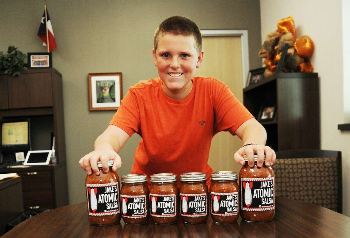 Jacob Johnson shows off his homemade salsa. The Cy-Fair Independent School District seventh-grader is a student at Salyards Middle School and has started a homemade salsa business that is heating up.
