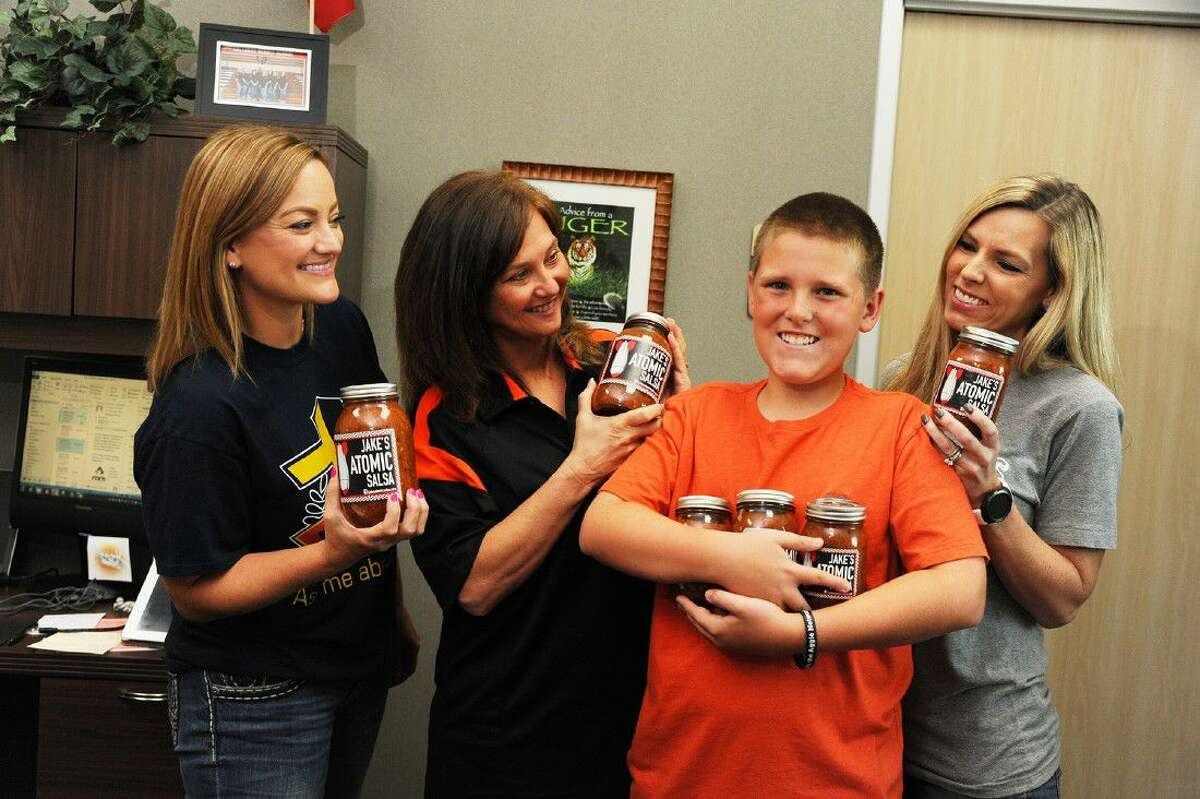 Salyards Middle School teacher Angie Buck and principal Liz Wood check out Jake's Atomic Salsa. The Cy-Fair Independent School District seventh-grader is a student at Salyards Middle School and has started a homemade salsa business that is heating up.