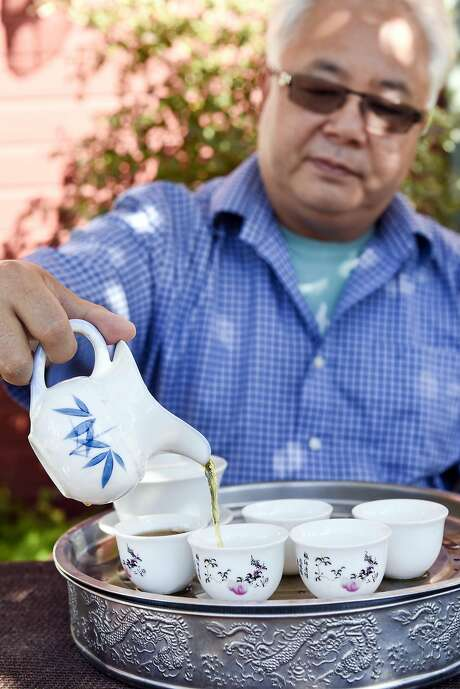 Roy Fong, owner of Imperial Tea Court, pours freshly brewed Keemun Mao Feng black tea on his farm in Esparto, (Yolo County). Photo: Michael Short, Special To The Chronicle