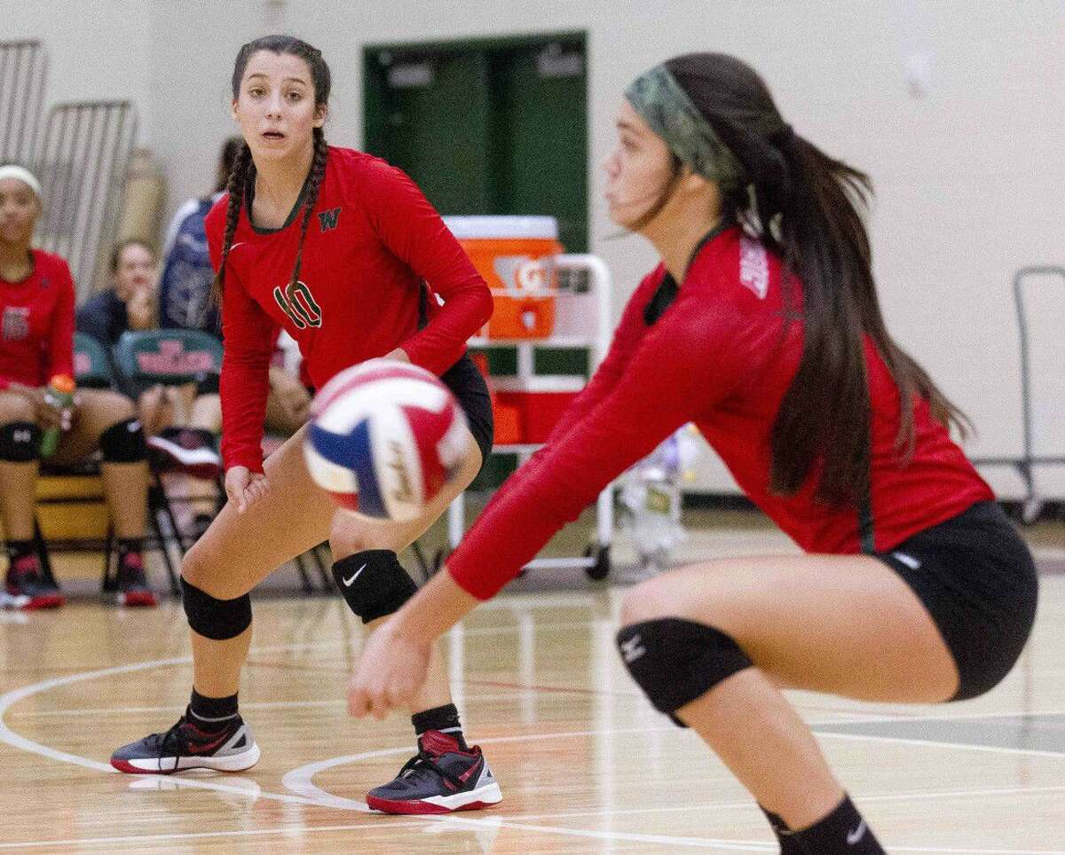 The Woodlands' Georgia Murphy (10) looks on as Dylan Maberry (9) tries to return a serve during the third set of a non-district volleyball game Tlast week against Tarkington.