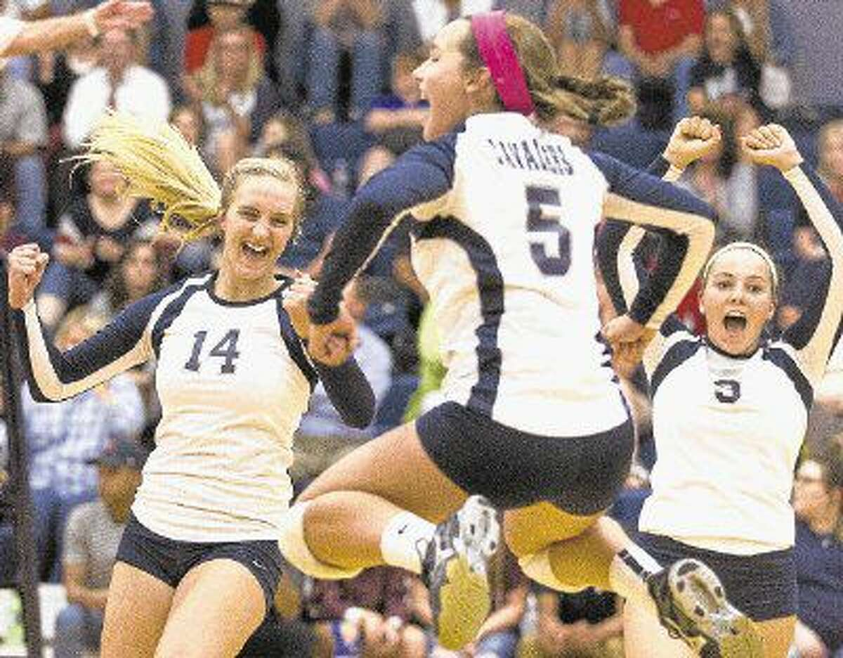 College Park's Cassidy Winsman, left, Jill Bohnet and Lauren Freeman celebrate winning the second set of a match against Magnolia earlier this season.