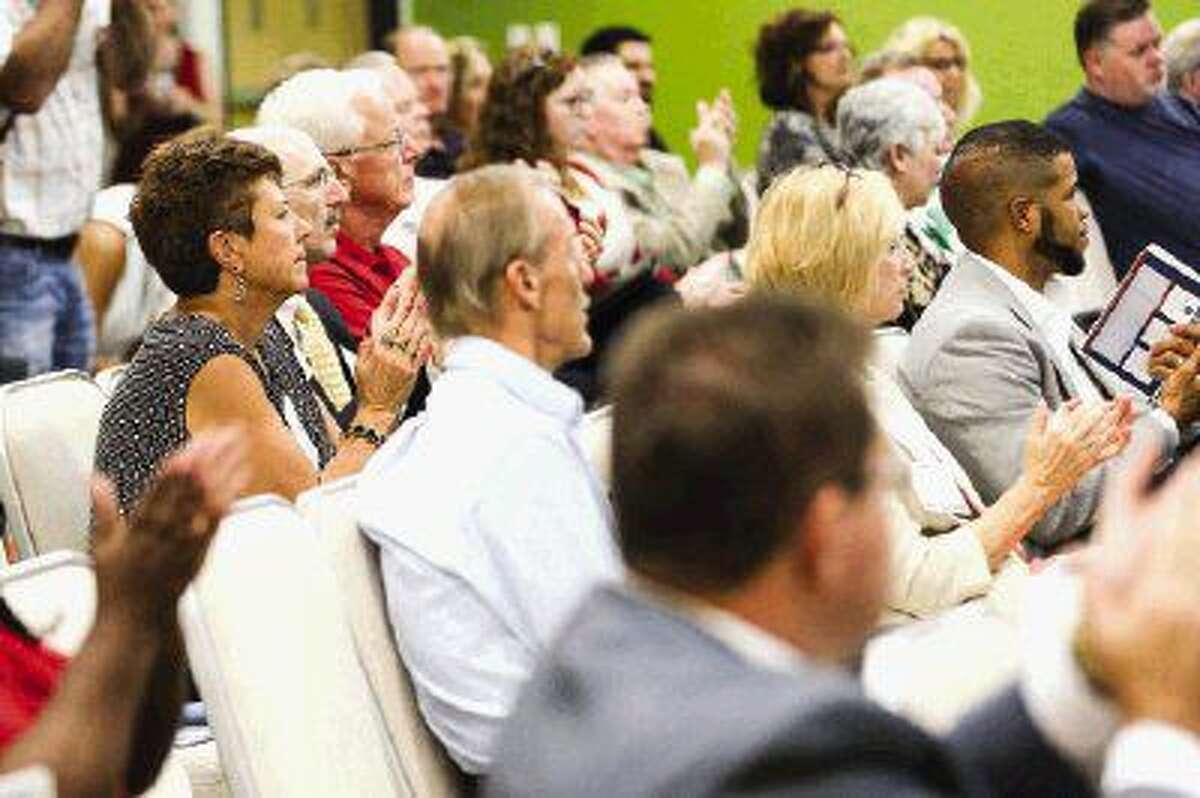 Audience members applaud during the Job Creators Network Event on Monday at Sam Houston State University's The Woodlands Center.