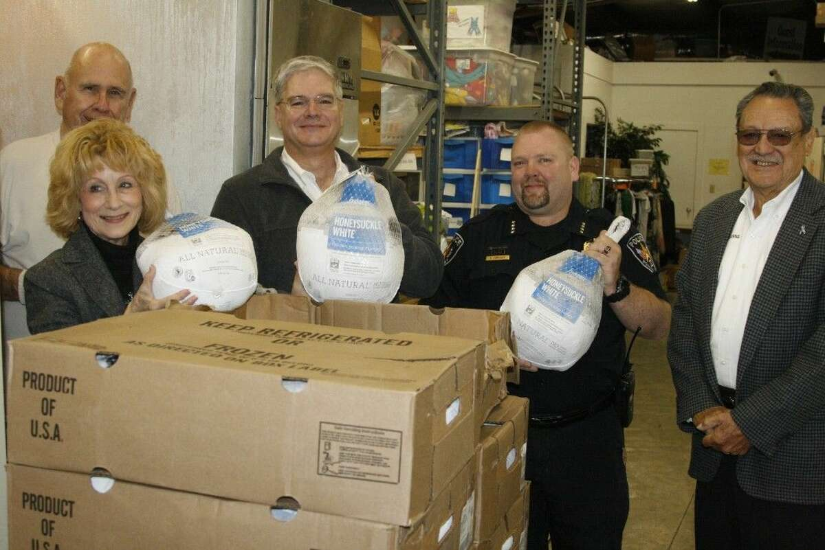 The Board of Directors of the East Montgomery County Improvement District spread a little Christmas cheer and dropped off 50 turkeys and 20 hams at the Mission Northeast on Wednesday, Dec. 10, 2014.