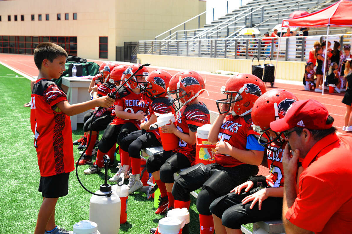 The Tomball Redcats rest during a timeout Saturday in the Mayor's Cup series. The team seeks to prepare the youth of Tomball to be not only football players in the future, but also community leaders.