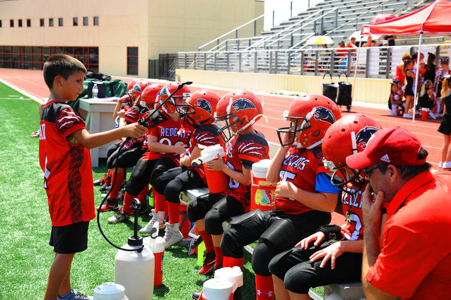 The Tomball Redcats rest during a timeout Saturday in the Mayor's Cup series. The team seeks to prepare the youth of Tomball to be not only football players in the future, but also community leaders. Photo: Tony Gaines