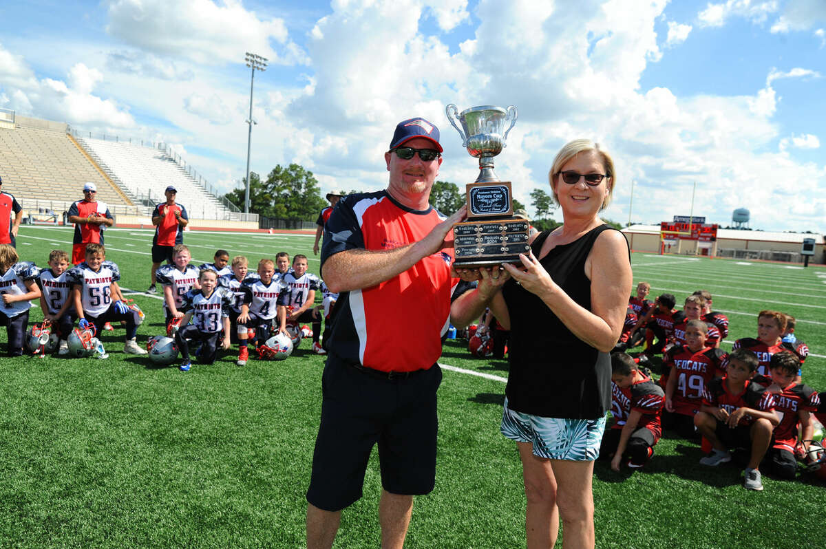 Tomball mayor Gretchen Fagan presents Mike Bauman the winning trophy following the Patriots win against the Redcats in game one of the Mayor's Cup Series. Redcoats Vice President Carl Monrad says that the Mayor's involvement and commitment to the games is invaluable.