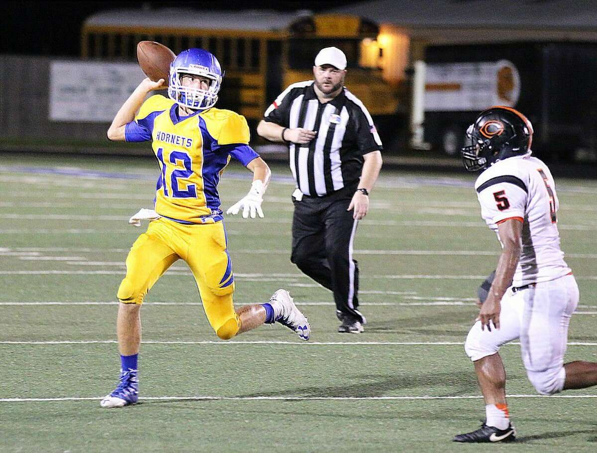 Hornet junior quarterback Ryan Guidry scrambles to get off a pass in Friday night's loss to the Centerville Tigers in a non-conference game.