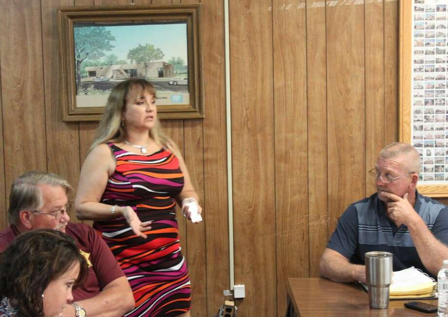 Mary Ann Saenz-Thompson (left) of the Texas Association of Counties explains the details of the United States Department of Labor's ruling on overtime to the San Jacinto County Commissioners Court on Sept. 13. Photo: Jacob McAdams