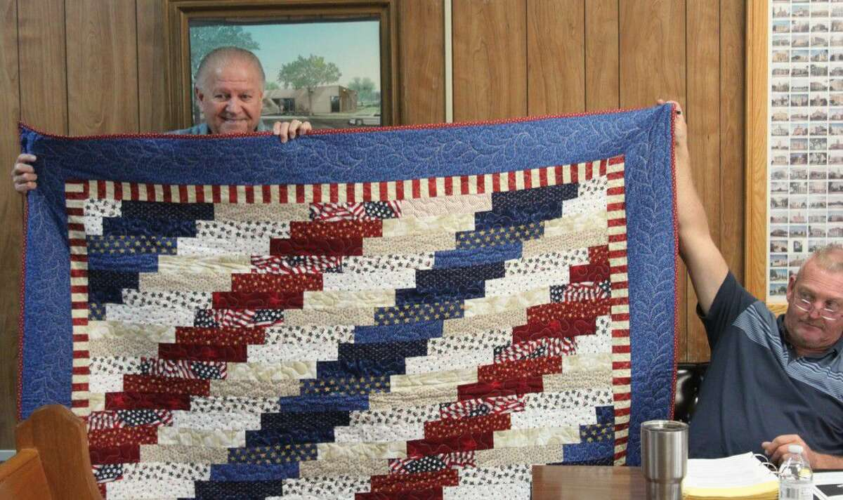 Dale Everitt (left) is presented with a Quilt of Valor at the San Jacinto County Commissioners Court on Sept. 13. The quilts are presented to veterans.