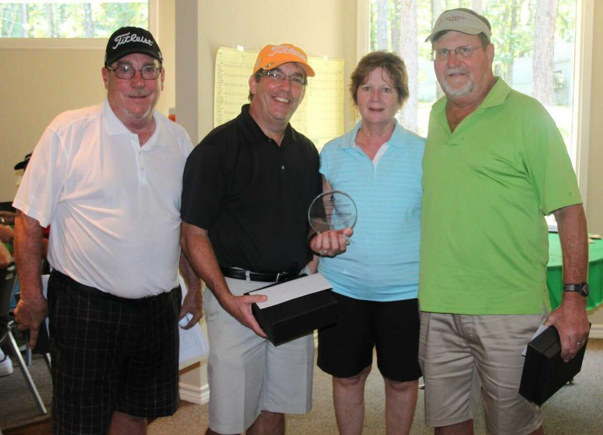 First place at the Terry Vaughan Classic golf tournament was awarded to this team consisting of Steve Weirich (left), Jim Bell (second from left), Pat Stephenson (second from right) and Russell Elfstrom (right).