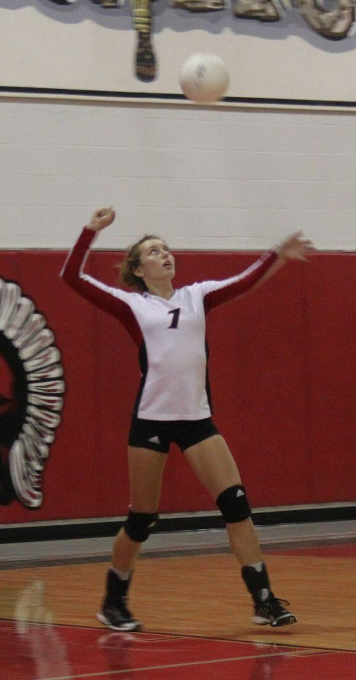 Sarah Heflin (7) of the Lady Trojans prepares to serve the ball.