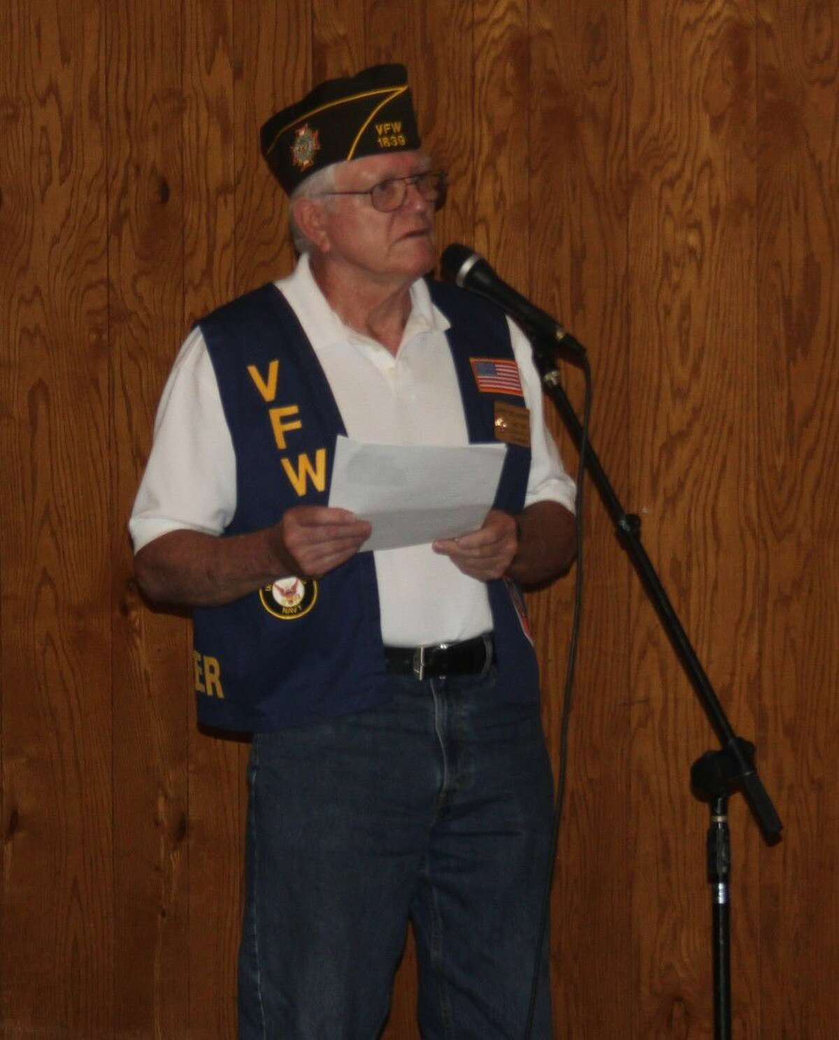 VFW Post 1839 Quartermaster Jerry Dellinger speaks before other members of the post and other guests as they take a moment to remember POWs and MIAs during National POW/MIA Recognition Day on Sept. 15.