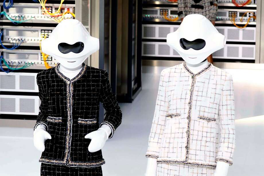 Chanel designer Karl Lagerfeld created a tech-inspired collection, including these robot helmets, for 2017spring/summer ready-to-wear collection fashion show in Paris. Photo: PATRICK KOVARIK, AFP/Getty Images