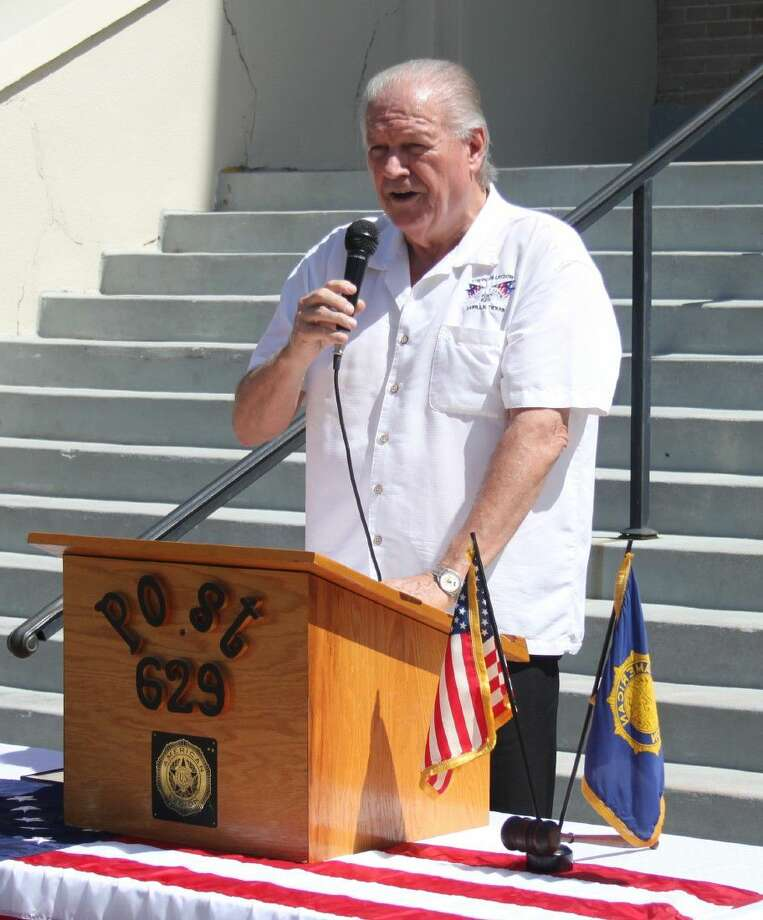 Dale Everitt of American Legion Post 629 gives a presentation to honor POWs on National POW/MIA Recognition Day, held at the San Jacinto County courthouse on Sept. 16. Photo: Jacob McAdams
