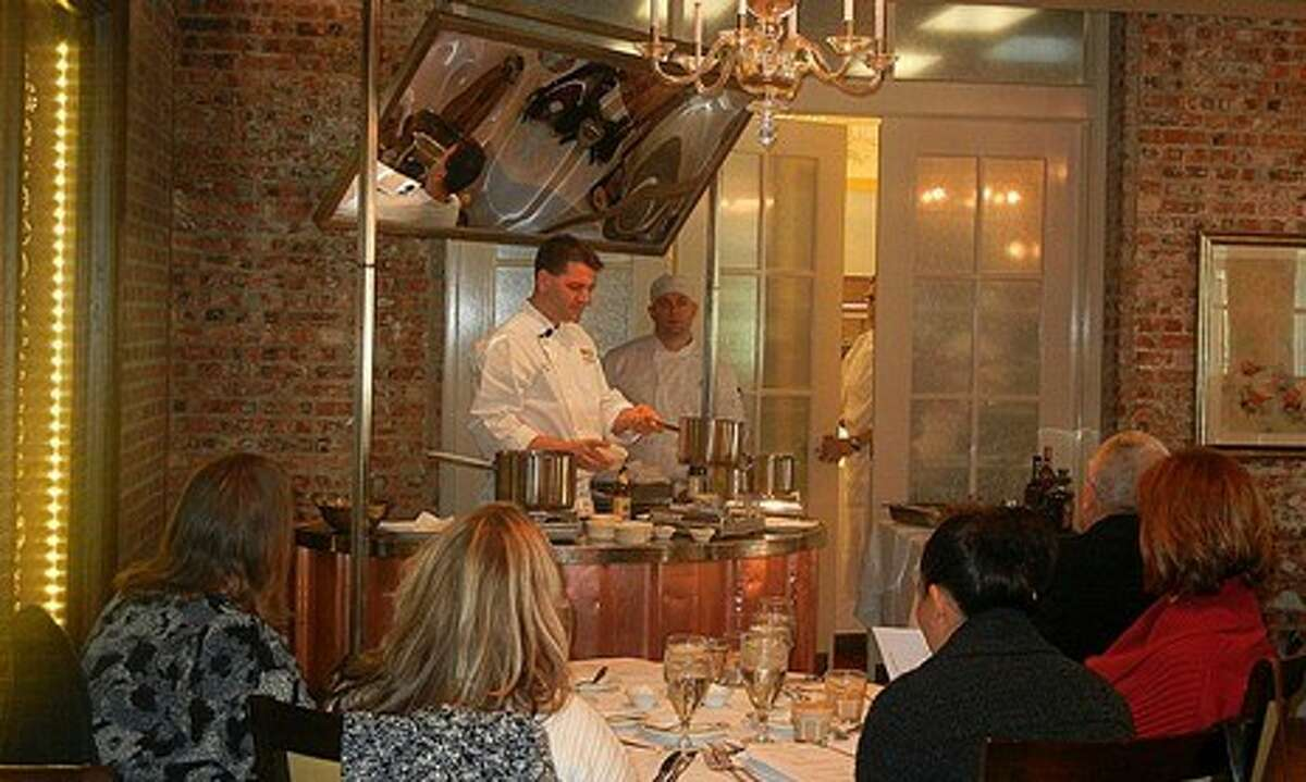 Brennan's of Houston Executive Chef Danny Trace cooks a three-course meal served with cocktails and wine chosen specifically for the menu during Summer Date Night Cooking Classes.