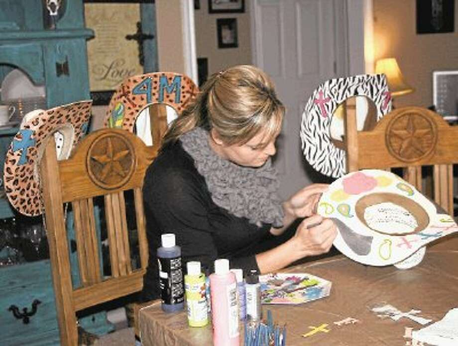 Tarkington resident Tammy McGrew paints custom cowgirl hats out of her home and is looking to branch out into more custom designs for cowboys and cowgirls. Photo: STEPHANIE BUCKNER / @WireImgId=2652149