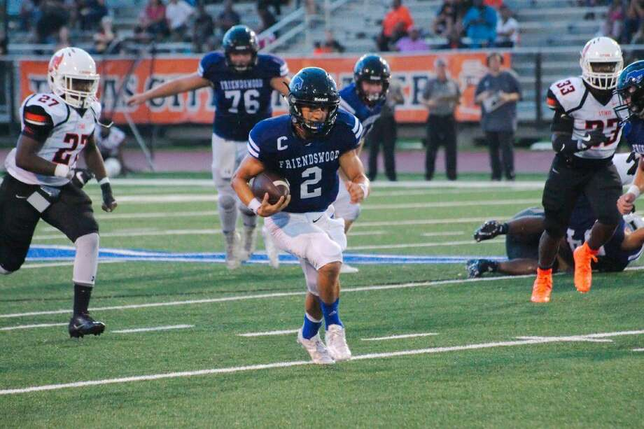 Friendswood' quarterbackTyler Page (2) will have his toughest challenge of the season against a fast, aggressive Dickinson defense. Photo: Kirk Sides