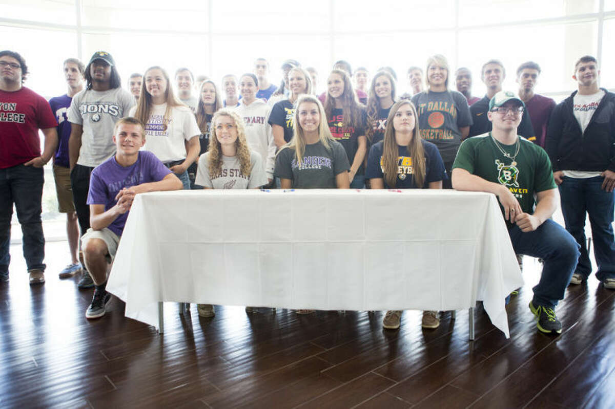 Students pose for a group photo during Humble ISD's Signing Day on May 14, 2014, at the Humble Civic Center.