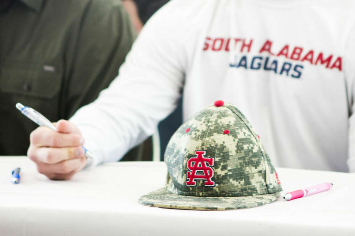 Kingwood's Antonio Cox displays his South Alabama colors during Humble ISD's Signing Day on May 14, 2014, at the Humble Civic Center.