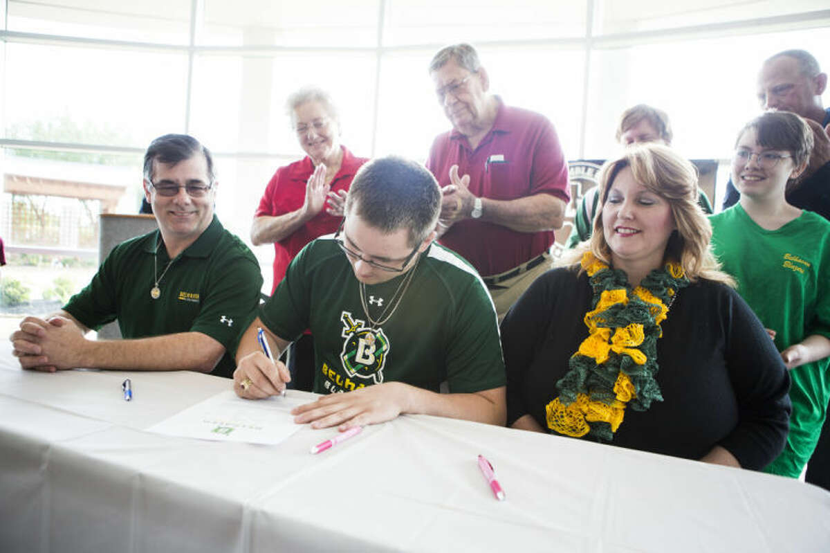 Atascocita's Steven Dishongh signs his Letter of Intent to play football at Belhaven University during Humble ISD's Signing Day on May 14, 2014, at the Humble Civic Center.