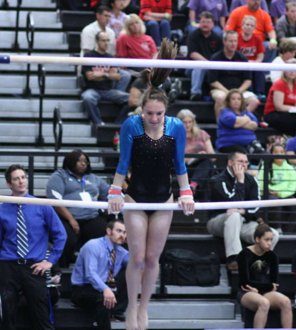 Kingwood's Madison Maxey on the uneven bars at the state championship.