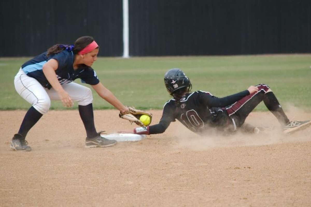 Pearland's Sydney Gutierrez (10), shown sliding into second base, belted a two-run triple Friday to help lead the Lady Oilers to a 14-2 win over Fort Bend Clements.