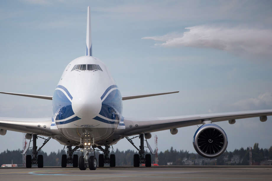 Fire trucks welcome AirBridgeCargo's new Boeing 747-8F freighter during the carrier's welcome to Sea-Tac Airport, Friday, Oct. 7, 2016. Photo: GRANT HINDSLEY, SEATTLEPI.COM / SEATTLEPI.COM