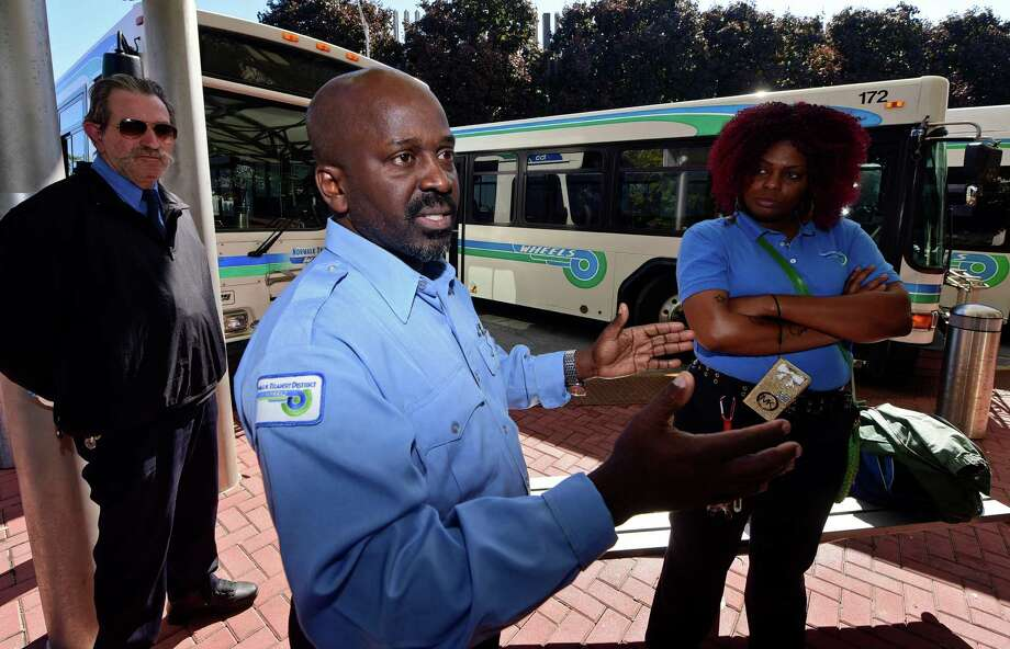 Norwalk Transit District Wheels bus drivers, including Erick Solomon, center, dispute Administrator Kimberlee A. Morton's assessment of why fare hikes and service cutbacks are needed to balance the budget during a press conference at the Wheels Hub bus station on Burnell Boulevard in Norwalk, Conn. Thursday, October 6, 2016. The drivers are presently working without a labor contract. Photo: Erik Trautmann / Hearst Connecticut Media / Norwalk Hour