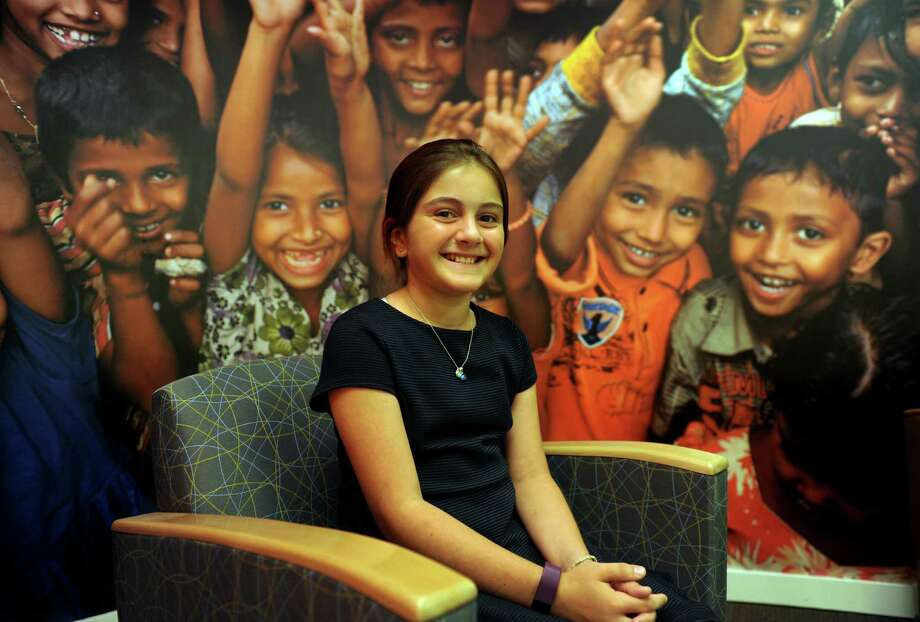 Norwalk resident Kate Papadatos, 10, poses at headquarters for Save the Children in Fairfield, Conn., on Wednesday Oct. 5, 2016. Papadatos will light the Empire State Building red with actress and Artist Ambassador Dakota Fanning on Tuesday in a special ceremony celebrating International Day of the Girl. Photo: Christian Abraham / Hearst Connecticut Media / Connecticut Post