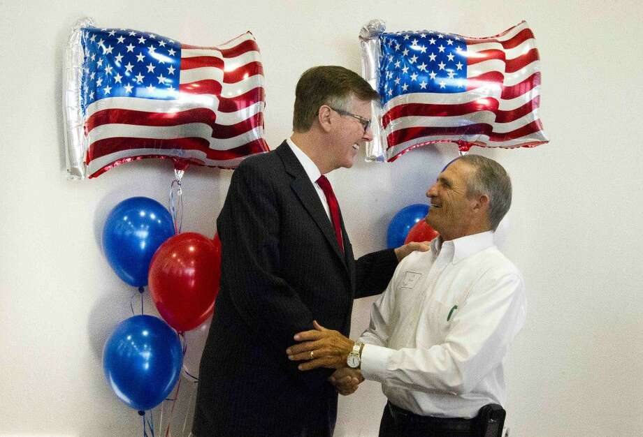 Texas Lt. Governor Dan Patrick, left, visits with J.R. Moore, former Montgomery County Tax Assessor-Collector, before the Montgomery County Republican Party's 'Get Out The Vote' rally Thursday in Conroe. Lt. Governor Patrick delivered the keynote address during the rally. Photo: Jason Fochtman